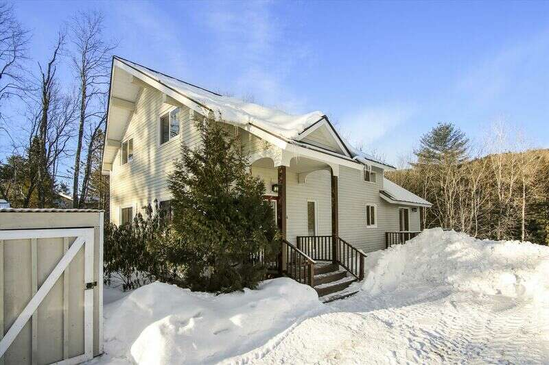 Enjoy this 8 bedroom rental in prime location! Perfect for a large group of skiers and riders. You will enjoy this vintage home as it has a rustic feel with a cozy living area, fireplace, and large walkout deck and a 6 person hot tub. Sleeping 16, this home is located 6.5 miles from the mountain and just 3 miles to the village. With this affordable rental you will get more than what you pay for! Come experience the life in Stowe at a great property that is priced right!