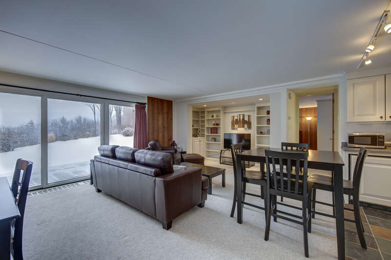 With a beautiful view of the rolling mountains, you cannot go wrong with this rental. Every room has a view of the ski trails in this comfortable and ultra-convenient Stowe condominium. Located just minutes from skiing, the condo sleeps 4 and offers easy access to the community heated pool, laundry facilities, tennis courts and sauna. One room includes a queen bed while the living room provides a pullout sofa.