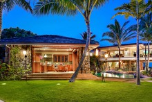 One of Oahu's finest beach estates, Royal Kailua is the crown jewel of Kailua beachfront property. It boasts an 11,000 sq. ft. 5 bedroom main house and a 3,000 sq. ft. 3 bedroom guest house. In this lush, gated beach estate, you will find all the amenities you need to have your own private resort; private beach access, large manicured lawn, waterfall, lagoon-style pool, jacuzzi, cabana w/ bbq, weight and exercise room, theater, sound system, library w/fireplace, pool table.