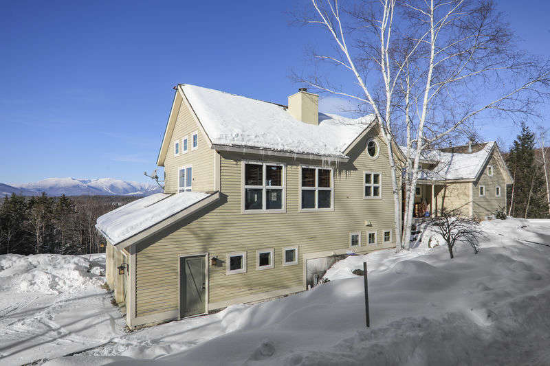 This Aspen style home has breathtaking views of Stowe and Mt. Mansfield, the major ski capital of the eastern United States. Impeccable detailed home! Cathedral ceilings and airy elegance! Minutes to Stowe Village and local restaurants, shopping, skiing, and recreation. Very private and serene, beautiful grounds with swimming pond, waterfall, mountain stream and hot tub with views.
