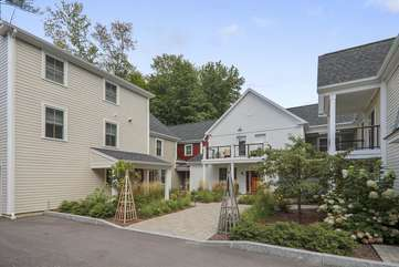 """Newly built in 2018, this Vermont oasis located in the Village Walk Townhouses is an easy walk to Stowe's popular dining and shopping establishments.For winter sports enthusiasts, the closest Mountain Road shuttle stop is only 0.3 miles from the door. Whether you ski, ride, hike or bike, Base Camp offers a central location to explore Stowe and the surrounding mountains while also providing a relaxing home at the end of each day's activities. This tastefully decorated unit features a fully equipped kitchen, dining area for six guests, and a comfortable living room with Jotul gas stove and Smart TV. The comfortable master suite is furnished with a king-sized bed and large full bath. Also on the first floor, you'll find a powder room, and access to the conveniently attached garage which is equipped with ski and snowboard racks. Upstairs, in addition to the two bedrooms, laundry, and full bath with tub and shower, there is an office area and outside deck. A """"pack and play"""" and folding cot are also available. Let Base Camp be the starting point for your next adventure!"""