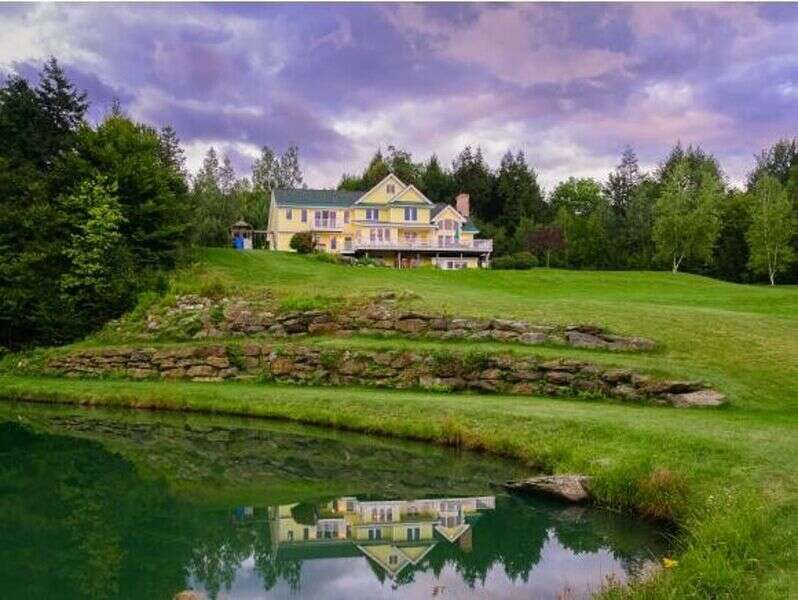Located in Stowe's prestigious Stowe Hollow enclave. Magnificent residence overlooking a large pond and unrestricted views of the Mt. Mansfield area scenery. Vaulted ceilings, a wood-burning fireplace, outdoor hot tub, fitness studio, large entertainment deck and a well designed, functional floor plan are perfect for a large family gathering. This home is ideal in offering both a large gathering Great Room and several areas for private relaxation. There is an enormous deck, complete with a grill, smoker, and plenty of seating. An open concept, well-equipped, kitchen/dining area. A Fitness Studio overlooking the mountains with a walkout to the fire pit. The private, spring-fed pond offers fun activities year-round. Canoe, kayak, ice fish, or fly fish for Rainbow Trout (poles provided). Enjoy the wildlife and star-gazing throughout the 4 acres of land.