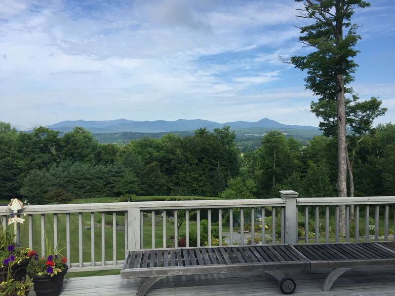 Stargazing, Sunsets and Serenity at this 10 Acre Retreat – Just minutes from Stowe! Thisrural country retreat on the doorsteps of Stowe villagesits on 10 acresof private wooded land. With room to sleep eight comfortably thismeditation paradise features million-dollar views of Mount Mansfield, a private swimming pond, and unique vista for daydreaming, stargazing and dancing in the moonlight! This two-level open concept home includes 4 bedrooms, 3.5 baths and features ample outdoor seating on thelargedeck that runs the length of the house highlighting fantastic views of the area ski trails. Located on themain floor are the kitchen and dining room, large living room with fieldstone fireplace, and half bath.Also on the main floor, the master bedroom has a king-sized bed, en-suite bath, and its own walk out to the deck. The lower level features entrance from the garage with full mudroom, walk-out access to the beautiful yard and pond, three bedrooms, two baths, a washer and dryer, and afamily room with largeTV, foosball and ping pong. The pristine property features a rock waterfall into the swimming pond with beautiful landscaping. This getaway is just minutes from outdoor adventure, restaurants, and cultural activities in Stowe. Nearby Moss Glen Falls and trail are a wonderful spot for a walk in the woods or dip in a mountain stream. Relax and unwind in this exceptional setting!