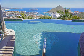 Located near the top of Pedregal Mountain, this dramatic brand new home offers spectacular views of downtown Cabo and the Pacific Ocean.