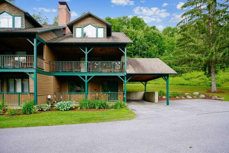 Spacious Mountain Retreat in Prime Ski in/Ski Out Location! Fun awaits in this 3 bedroom,4 bathroom Mountain Condo just steps from the Toll House area of Stowe Mountain Resort! The three-level home is appointed with wood accents throughout and is set in a quiet location near the Mountain Road, providing easy access to all outdoor four-season activities. The lower level has a bedroom with two queen beds and a pull-out sofa, full bath, and washer and dryer. The main level's gathering space includes a fully equipped kitchen, dining area, full bath, living room with gas fireplace, and doors that open to a covered deck. The upstairs includes two bedrooms, each with king-sized bed and en-suite bath. This is the perfect spot for a getaway with the whole family or for a few couples with hiking and skiing right outside your door!