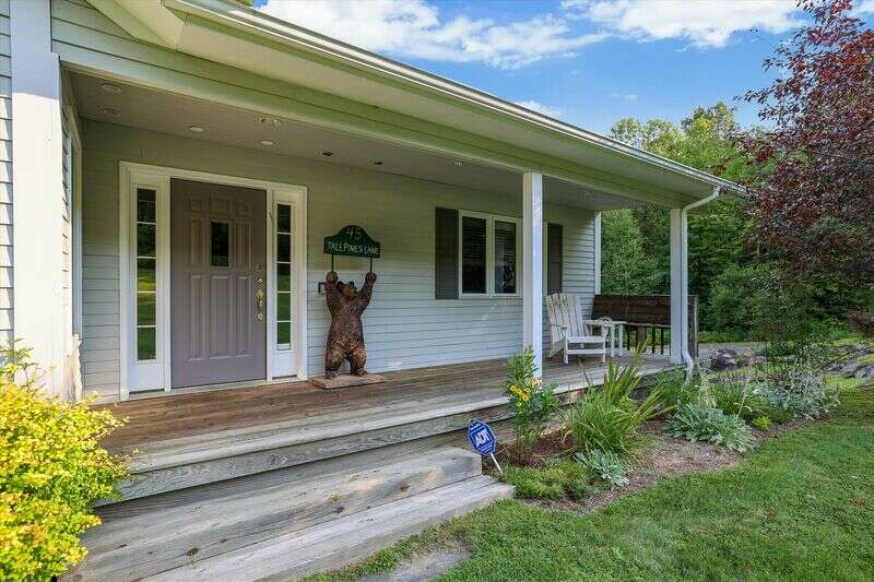 A Welcome Vermont Retreat in the Heart of Stowe Hollow! This inviting four bedroom, three bathroom haven sleeps 10 and is the perfect spot for a family vacation.The main level features hardwood floors and inviting open spaces with a peaked wooden plank ceiling. A gorgeous kitchen with an island that seats three opens to a large dining area that seats 10, as well as anairy living area with a stunning rock wall gas fireplace and overmount TV. Alsoon this level are the den seating area and elliptical machine, mudroom, and washer/dryer. This level features two bedrooms, one with a King bed and a shared bath, and an expansive master suite with King bed, full bath, large closet and sliding glass doors to the deck. The lower level of the home includes two more bedrooms, each with Queen sized beds and a shared bath, and a game room with seating area, pool table, and walkout access to the yard. An entrance from the two-car garage is also on this level. The outdoor space includes the large deck that runs the length of the main level, including a comfortable sitting area with shade covering, dining table, and gas grill. The deck overlooks a lovely pond and large back yard. The home is located off Dewey Hill and the Gold Brook area of Stowe Hollow. With just a short drive to excellent hiking at the Stowe Pinnacle and Hunger Mountain trailhead, Tall Pines Lodge is the perfect spot for an active andfunfamily escape!