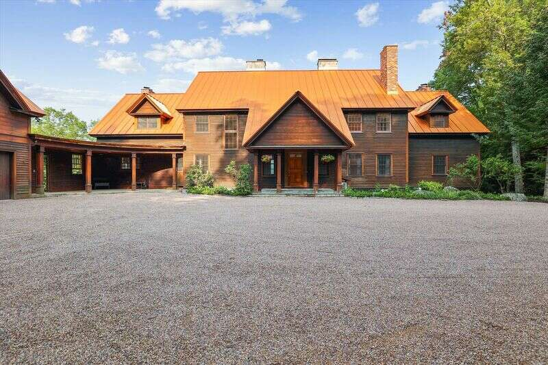 NINE HEARTHS, famously featured on BRAVO's Winter House-Southern Charm Television Series and named for its 9 roaring fireplaces, commands spectacular panoramic sunset views of Mt. Mansfield, and the valley. This 3- level, private 18-acre compound, is accessed through a security gate to a rolling drive delivering guests to this 7-bedroom/6½ bath estate designed by award winning Yale Architect, George Hathorn. Enter the atrium under a cathedral ceiling showcasing stunning vistas through a wall of windows decorated with carefully selected Americana artwork and Restoration Hardware Furnishings. Enjoy cooking in the cozy country kitchen with granite counters while relishing breakfast beside the raised hearth; eat fireside in the formal dining room; and relax in the cozy living area with another focal fireplace. Main floor includes granite-faced walls, a cherry-paneled library with fireplace, and a guest bedroom with a marble bathroom. Upstairs there are 4 bedrooms connected with an atrium balcony. The upstairs features the master bedroom suite, with a walk-closet, a fireplace, and an Alpe Verde Marble bathroom, 2 additional bedrooms suites with fireplaces and a fourth bedroom. Multiple walk-out decks on both the upper and lower level overlook a manicured lawn, woodlands and unobstructed views of Mount Mansfield and the Worcester Range. The lower level also features the family room, full-service laundry room, full bath, kids' dormitory with bunks, and a game room featuring a pool table, foosball table, ping pong table and shuffle board. Additionally, above the garage, there is a 2-bedroom apartment loft with one full bathroom, full kitchen, dining area, and washer/dryer, as well as a beautiful walk out patio overlooking the pond. Added features include a ten-person hot tub, private pond with dock, outdoor sculptures, an orchard, a spice garden, hiking trails, and wall-mounted A/C units for your comfort. This secluded property is just minutes to Stowe Village, groceries an