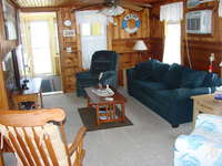 Comfortable living area with plenty of seating.  A/C unit and overhead fan.