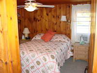 Master bedroom with queen size bed, AC and small TV