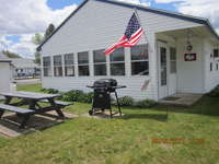 Cottage is located close to the pool, laundry room and office. Nice yard with picnic table and private grill.