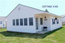 Welcome to cottage #105. Our cottage includes a recently renovated three season porch, two bedrooms, one and a half baths, and a comfortable living room kitchen combination.
