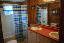 Full Bath with double sink, cabinet storage