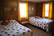 Second Bedroom with 2 full size beds, bureau, rocking chair, small TV with PS2 gaming unit.  Air Mattress is located in the closet and fits between the two beds.