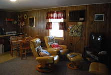 2nd view of Family room - TV, VCR, DVD, and WII Gaming Unit with Controllers, Nunchunk, multiple family games.
