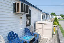 Outside Deck with seating for 5 and an enclosed storage cabinet.
