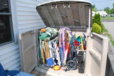Storage Deck Unit with Beach Chairs, Beach Wagon, Sand Toys, Scooters, Boogie Boards.