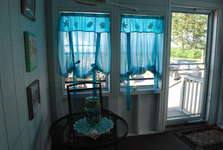 Enclosed porch with table and chair for 6