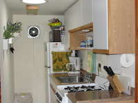Fully equipped kitchen with microwave, stove with oven refrigerator.  Lobster pot available.