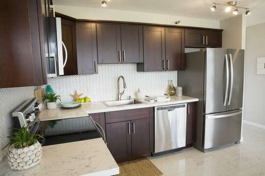 full kitchen with dishwasher, microwave and full convection oven