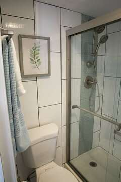 separate shower and bathroom area
