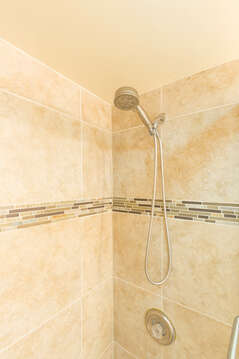 Shower with hand-held faucet