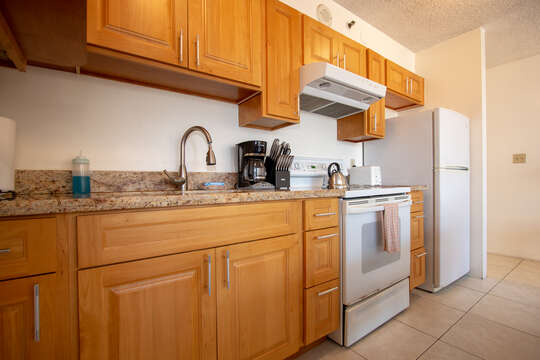 Kitchen featuring wood cabinets