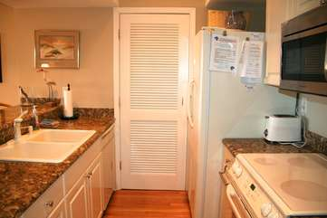 There is storage in the closet for pantry items.