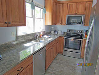 Beautifully remodeled kitchen boasts all new stainless steel appliances, granite counter tops and new cabinets!