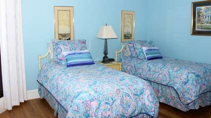 The 2nd bedroom has two twin beds.
