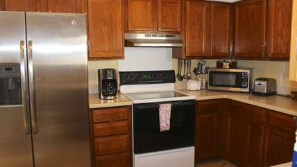 There is a stainless refrigerator and all the conveniences of home.