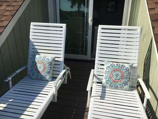 Relax on the chaise lounges on the upper deck!