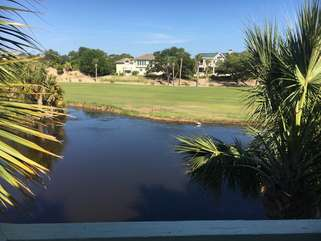 There are panaromic views of the golf course from this great deck.