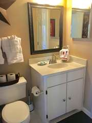 Access the 2nd bathroom from the guest bedroom or kitchen.