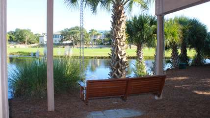 Nestled next to the lagoon, the swing is the perfect place to relax grilling.
