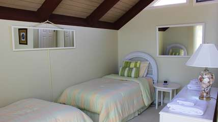 The loft bedroom has two twin beds and a sun deck.