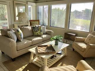 A wall of windows offers fabulous views of the lagoon and allow great sunlight.  New sofa has been added too!