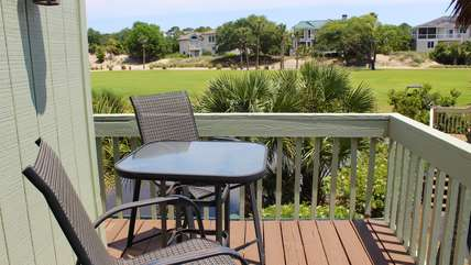 Sip coffee on the private deck while watching the golfers on the 11th hole.