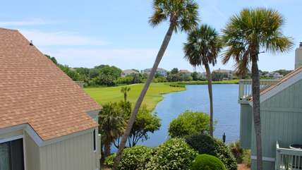 This cottage overlooks a lagoon jumping with fish and the golf course.
