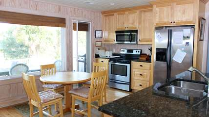 This spacious kitchen has granite counters and stainless appliances.