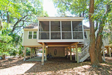 Rear view of 529 Tarpon pond and screened porch.