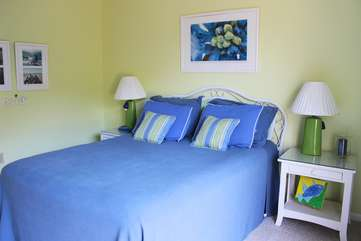 The 2nd bedroom is upstairs and has a bright and cheery decor.