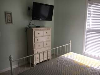 Enjoy the large mounted flatscreen TV in the master bedroom too.