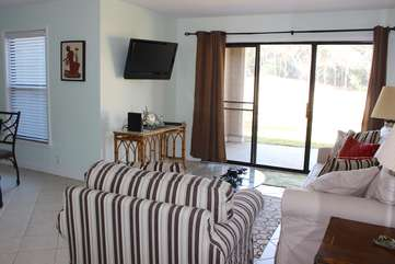Tile flooring a large HDTV & open floor plan make it perfect for your vacation.