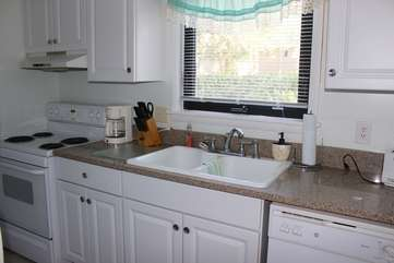 The kitchen has been totally updated and includes granite countertops.