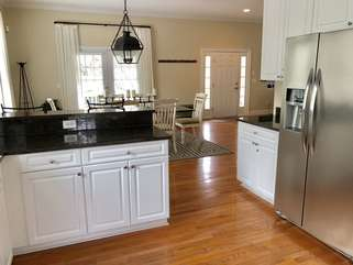The open kitchen features stainless steel appliances and plenty of counter space.