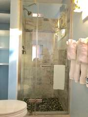 Renovated master bathroom shower looks beautiful!