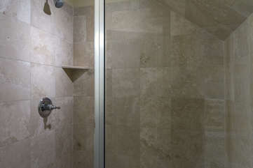 The master bath has a large tiled shower.