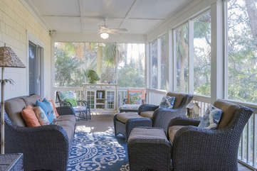 A screened in porch has fabulous views to the golf courses.