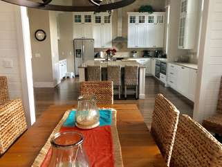 Kitchen and dining area are integrated., with the dining room table offering seating for 10.