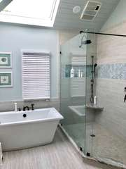 Stunning custom tile and cabinetry with soaking tub